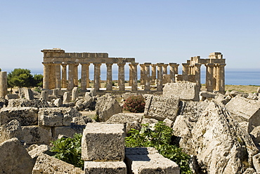 Remaining rubble of Temple G and Temple E (back) at the ancient Greek archaeological site in Selinunte, Sicily, Italy