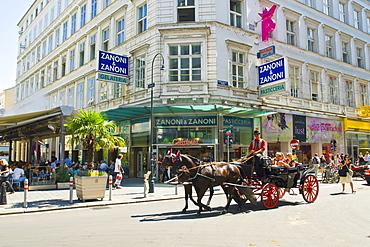 """""""Fiaker"""" Hhorse coach in front of Ice cream parlour Zanoni and Zanoni, Vienna, Austria"""