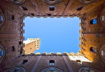 Look from the courtyard of the Palazzo Pubblico on the Torre del Mangia Siena Tuscany Italy