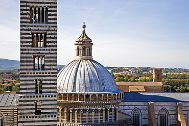 Cathedral cupola and tower of the cathedral of Siena Tuscany Italy