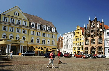 BRD Germany Mecklenburg Vorpommern City Stralsund Historical Houses in the Down Town at the Market Place and Tourists