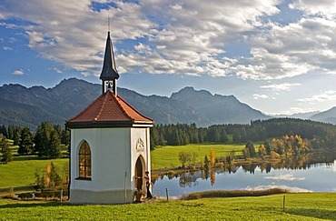 Chapel at a small lake in Autumn, Visitor at the Chapel, Buching, Allgau, East Allgau, Bavaria, Germany, BRD, Europe,