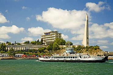 Sightseeing Ship near Harbour Quay with the big Memorial of 2. World War in the background, Sevastopol, Crimea, Ukraine, South-Easteurope, Europe,