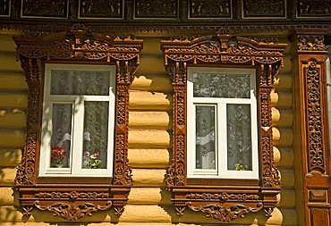 Decorated window frame of a timber building, Russia