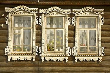 Decorated window of a Russian wooden house, village Lomovka, russia