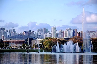"""Fountain in the Ibirapuera Park in the Southern Zone of Sao Paulo, Brazil. In the background the skyline of """"Zona Sul"""""""
