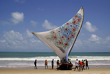 Traditional fishing boat (Jangada) arriving after three days on sea, Iguape near Fortaleza, Ceara, Brazil