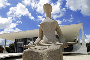 Sculpture of Lady Justice in front of Brazilᄡs supreme court, Brasilia, Brazil. Architect: Oscar Niemeyer