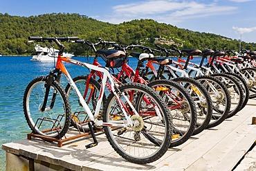 Lined up bicylces, bicycle hire in Polace, Mljet Island, Dubrovnik-Neretva, Dalmatia, Croatia, Europe