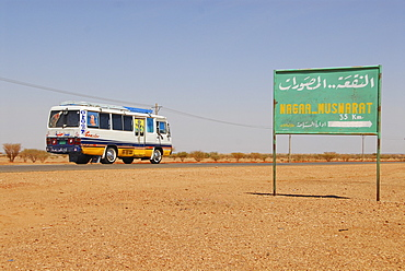 Bus on a country road near Naga, Sudan, Africa