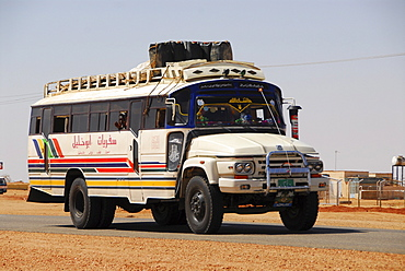 Bus on country road near Naga, Sudan, Africa