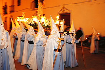 Penitents wearing penitential robes (nazareno), Holy Week procession, Semana Santa, Belmonte, Castilla-La Mancha region, Spain