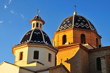 Tiled domes of the golden yellow Iglesia de Nuestra Senora del Consuelo Church, Altea, Costa Blanca, Spain
