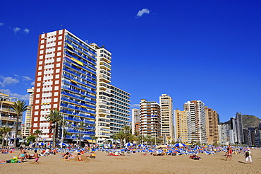 Tourists and high-rises on the beach at Benidorm, Costa Blanca, Spain