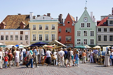Visitors at the medieval market at the square in front of the town hall in Tallinn, Estonia, Europe