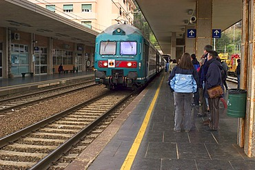 Tourists waiting for the regional train at the station of Levanto, Terre, Liguria, Italy