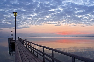 Landing stage after sunset, Lake Chiemsee, Bavaria, Germany