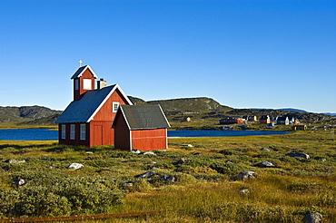 Church beside a lake and village, Ilimanaq, Greenland, North Atlantic