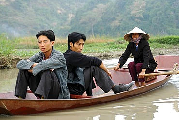 Three in a boat Perfume river Vietnam