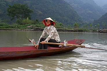 Rowing woman on the Perfume River Vietnam