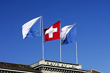 Flags of Switzerland and the Canton Zurich on the roof of the luxury hotel Baur au Lac, Zurich, Switzerland