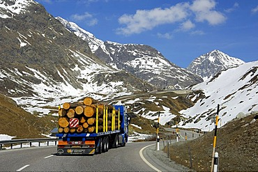 Truck transporting logs on the way up to the Julier Pass, Graubuenden, Grisons, Switzerland