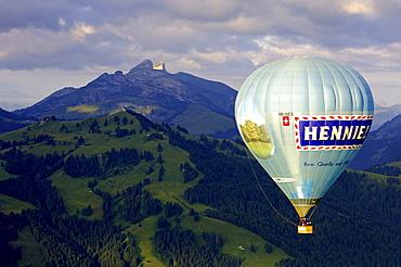 Hot air balloon in front of peaks Tour d'Ai, Tour de Mayen, Chateau-d'Oex, Switzerland