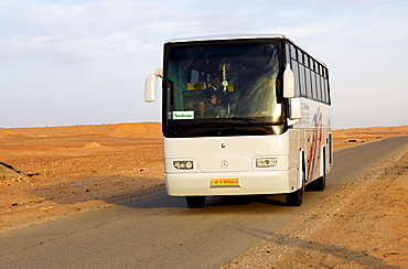 Coach with a package tour group of the German travel agency Studiosus travelling in North Africa, Libya