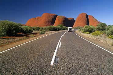Car driving in front of the Kata Tjuta (Olgas), Uluru - Kata Tjuta national park, Australia