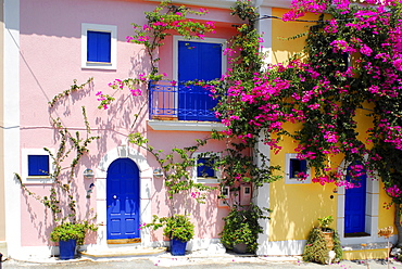 Pink and yellow house, blue shutters, Fiscardo, Kefalonia, Ionian Islands, Greece