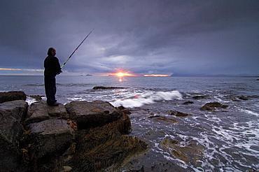 Fisherman on the beach, Lofoten Archipelago, Norway, Scandinavia, Europe