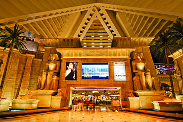 Palms, giant monitor and statues of Tutankhamun in the lobby of the Luxor Hotel & Casino, Las Vegas Boulevard, Las Vegas, Nevada, USA, North America