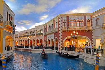 Gondola and tourists under an artificial sky in a recreated Venice, interior of the Venetian Resort Hotel & Casino on the Strip, Las Vegas Boulevard, Las Vegas, Nevada, USA, North America