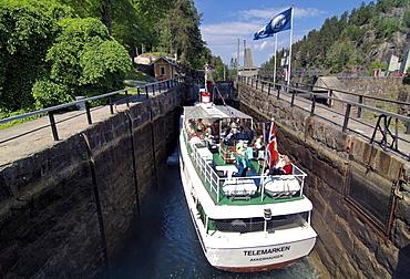 """Telemarken Akkerhaugen"" tourist boat in a canal lock, Vrangfoss Lock-Chamber, Telemark Canal, Telemark, Norway"