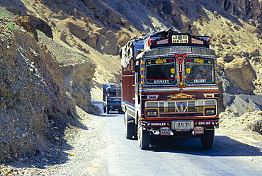 Colourfully painted truck driving along the main highway between Kashmir and Ladakh, India