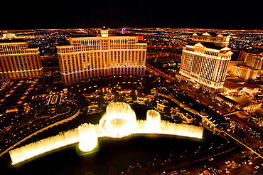 Nighttime aerial view of the fountain in front of the Bellagio and Caesars Palace Hotels and Casinos, Las Vegas, Nevada, USA