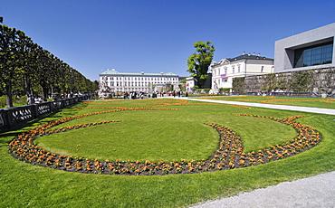 Arranged flowerbeds, Mirabellgarten or Mirabell Gardens and the Mirabell Palace, Salzburg, Austria, Europe