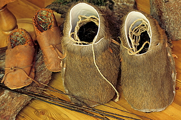 Leather shoes, moccasins made of fur and straw in the Oetzi or Iceman Museum in Oetzi Village, Tyrol, Austria, Europe