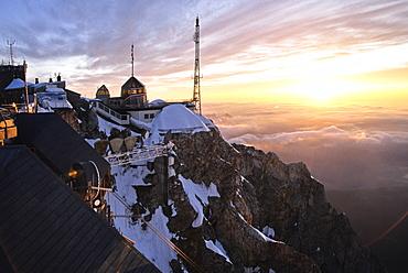 Austrian mountain hotel on Mount Zugspitze at sunset, Tyrol, Austria, Europe