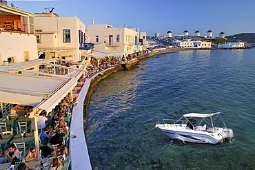 Tourists seated at restaurants in Little Venice and windmills, collage containing a motor yacht, Mykonos Island, Cyclades, Greece, Europe