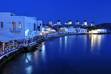 Tourists seated at restaurants in Little Venice, windmills, evening mood, Mykonos Island, Cyclades, Greece, Europe