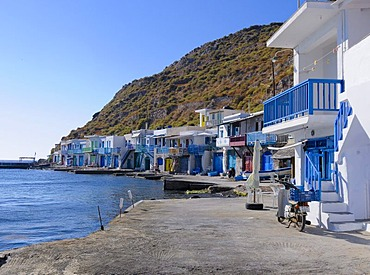 Colourful houses beside the harbour of the fishing village of Klima on Milos Island, Cyclades Island Group, Greece, Europe