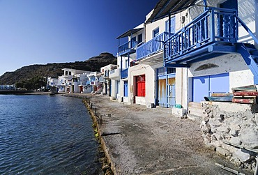 Colourful houses beside the ocean of the fishing village of Klima on Milos Island, Cyclades Island Group, Greece, Europe
