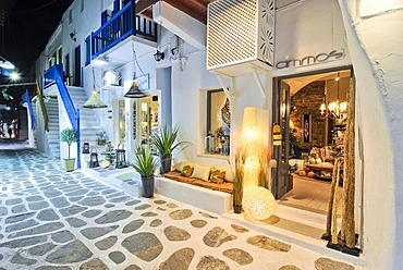 Illuminated alley with shops at night in Mykonos, Cyclades, Greece, Europe