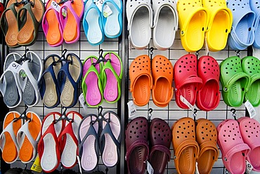 Colourful sandals, Crocs, hanging from a stand at a sales booth, Greece, Europe