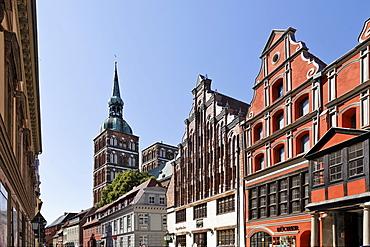 View of pharmacy and St. Nicholas Church in background, Badenstrasse, Stralsund, Mecklenburg-Western Pomerania, Germany, Europe