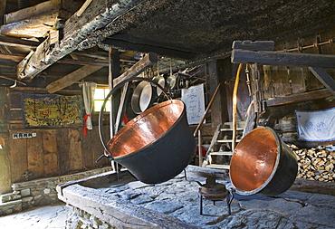 Copper kettles in a rustic kitchen, Weissalm alpine pasture, Grossarltal, Salzburg, Austria, Europe