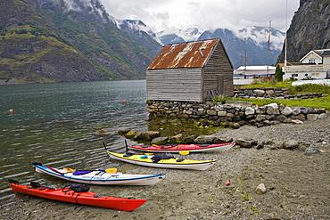 Kayaks on Undredal Beach along the Aurlandsfjord, Norway, Scandinavia, Europe