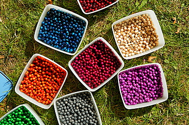 Containers filled with colourful beads for crafting