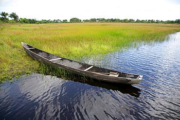 Wooden canoe at the shore of Lake Capoey, Guyana, South America